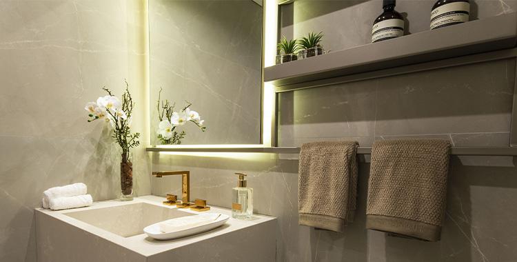 Uma fotografia do lavabo do apartamento decorado do Gabell Jardins.