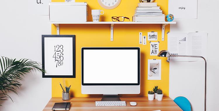 Uma fotografia que ilustra um pequeno escritório em casa.
